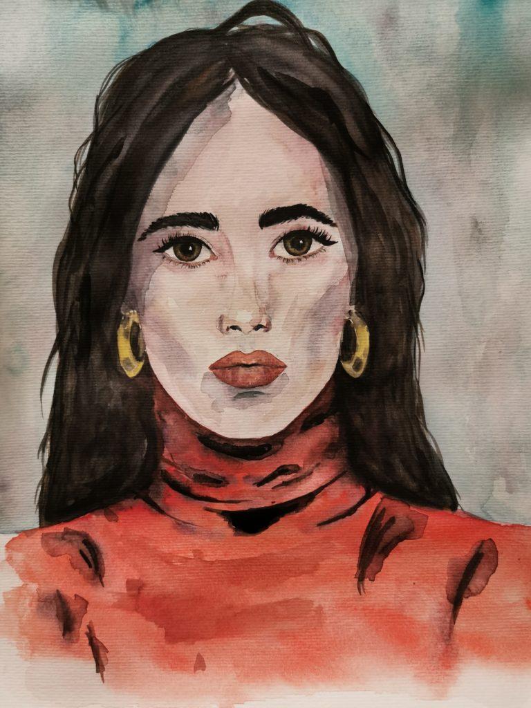 starke junge Frau mit brunetten langen Haaren, goldenen Creolen und einem roten Rollkragenpullover, mit starkem Blick schaut sie den Betrachter direkt frontal an